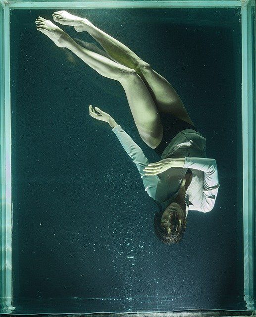 conceptual photography underwater woman