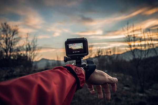 Action camera attached on hand