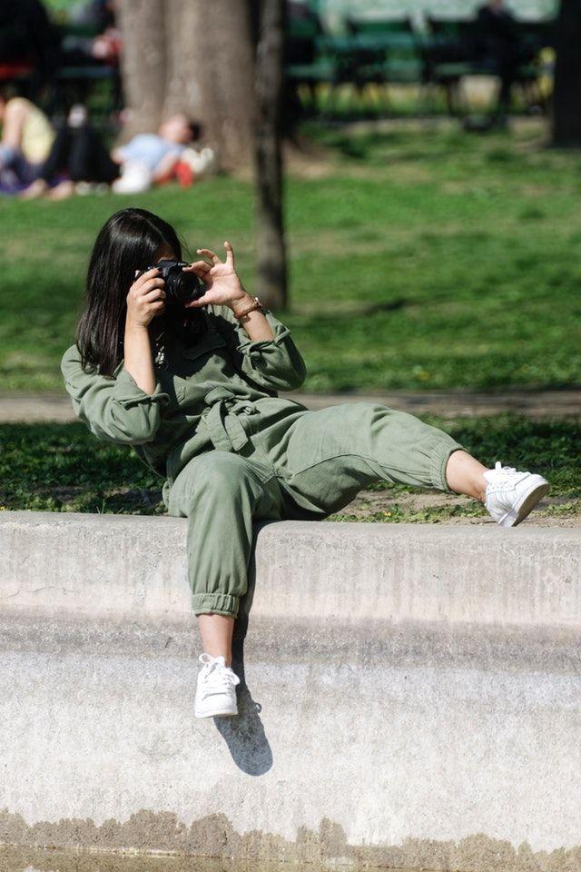 hobbyist female photographer in action