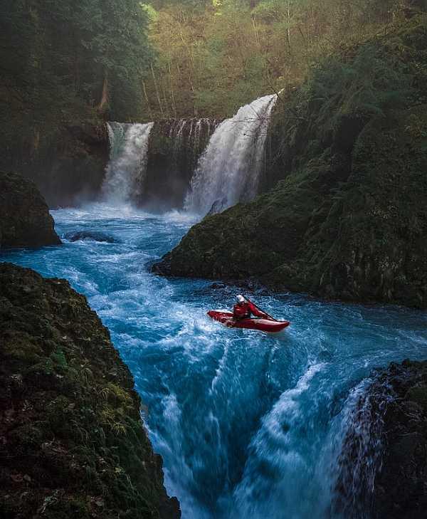 Watercraft near the waterfall