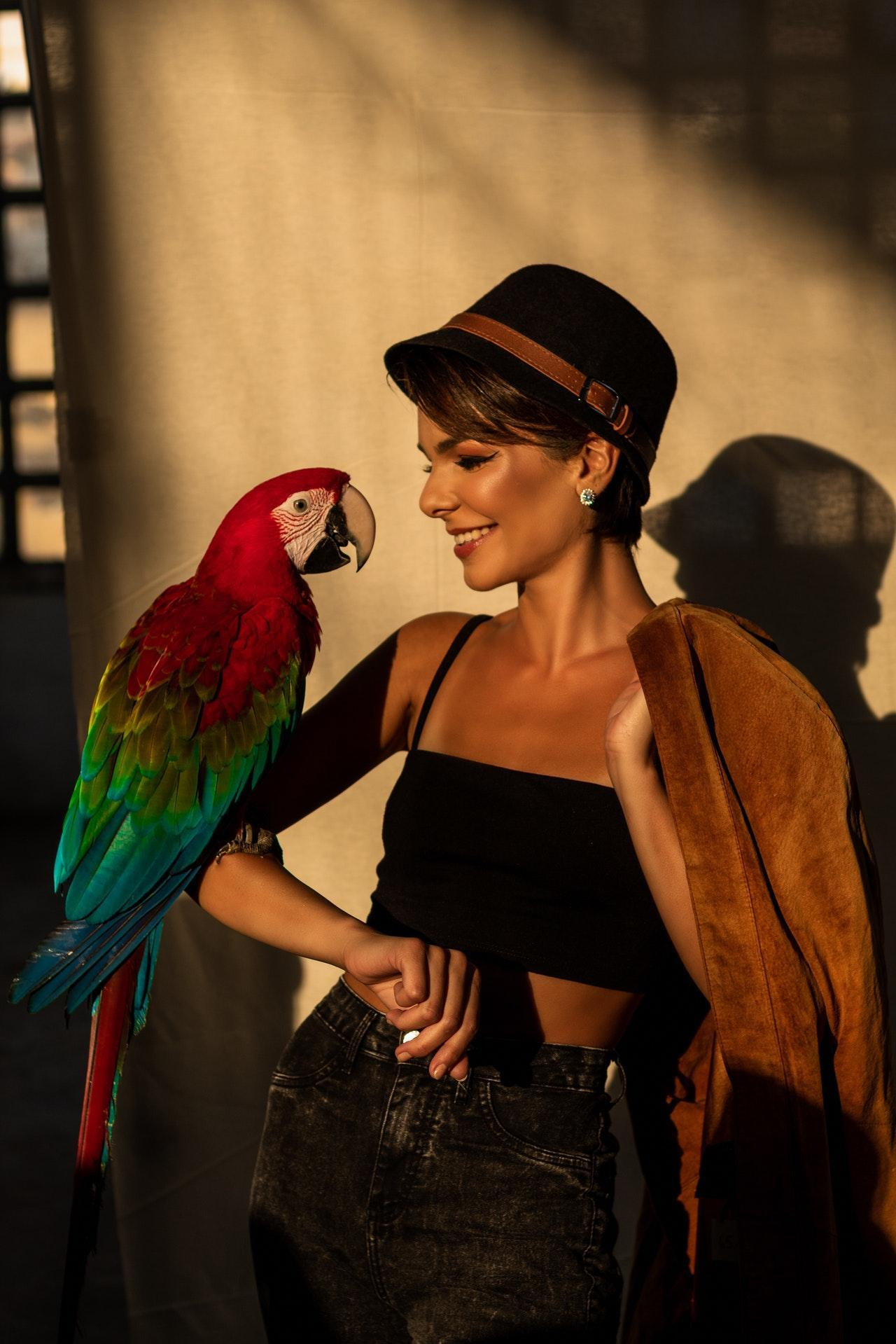 Woman with her parrot