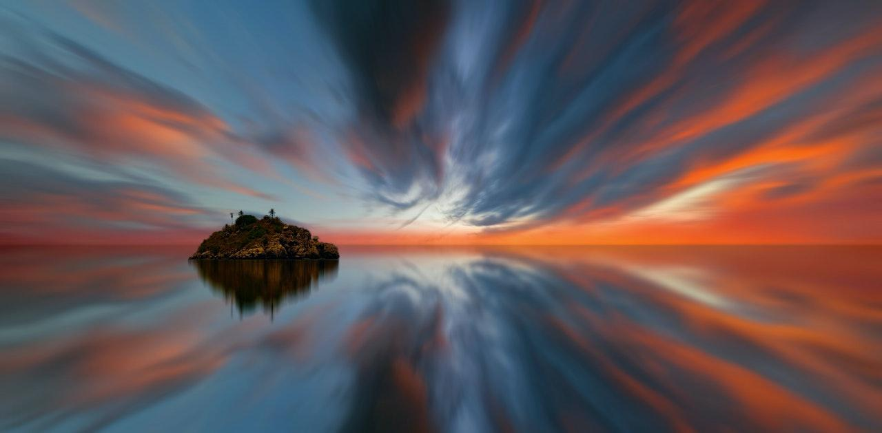 Long exposure surreal with an island at sunset